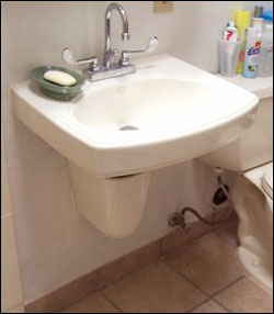 Wall hung accessible sink for wheelchair users for Wheelchair accessible sink bathroom